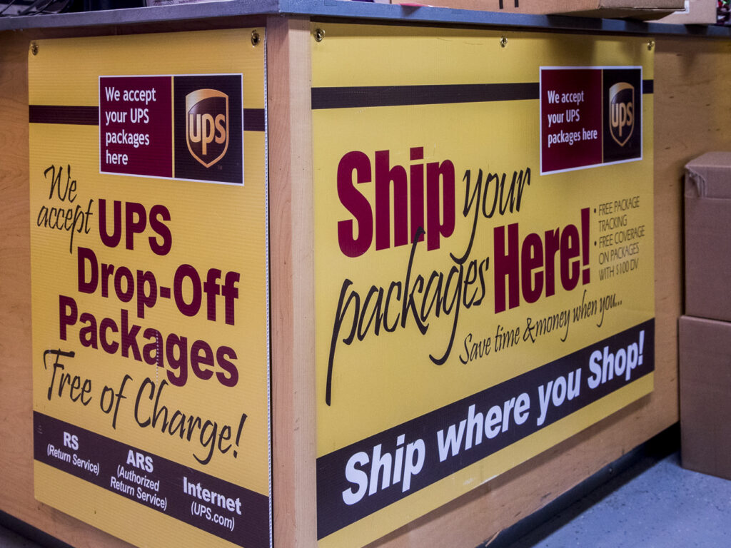 A UPS Sign saying Ship your packages here!
